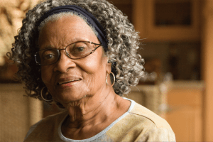 Portrait of an older African American woman looking at camera